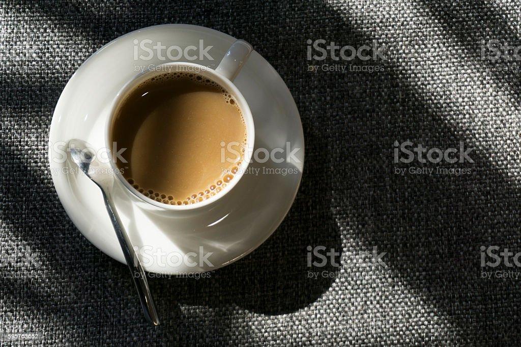 coffee cup on sofa in sunlight stock photo