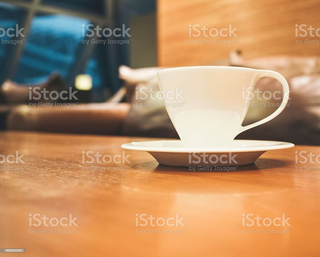 Coffee cup on table with blurred shop cafe Interior stock photo