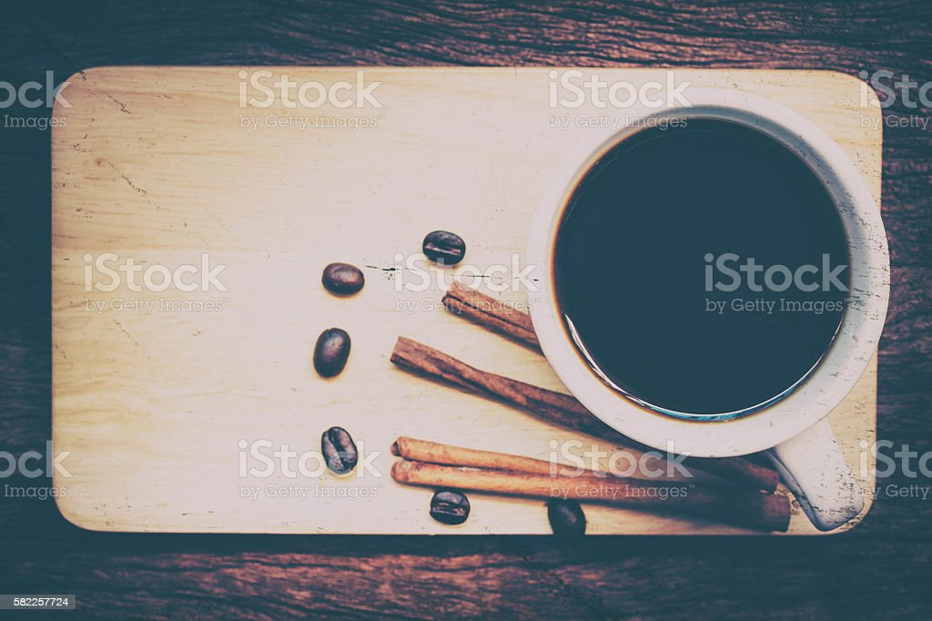 Coffee cup on the beans on wood. stock photo