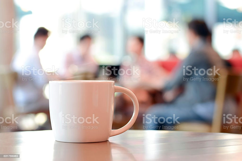 Coffee cup on the table in coffee shop stock photo
