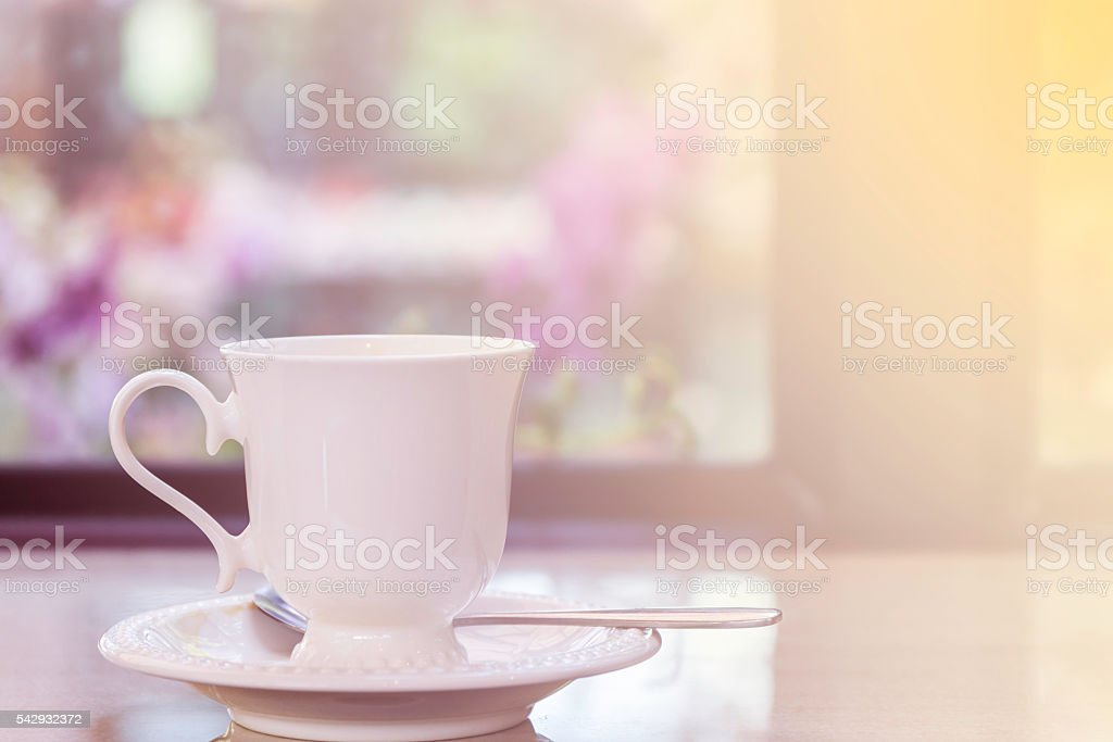 Coffee cup on the table in coffee shop. stock photo