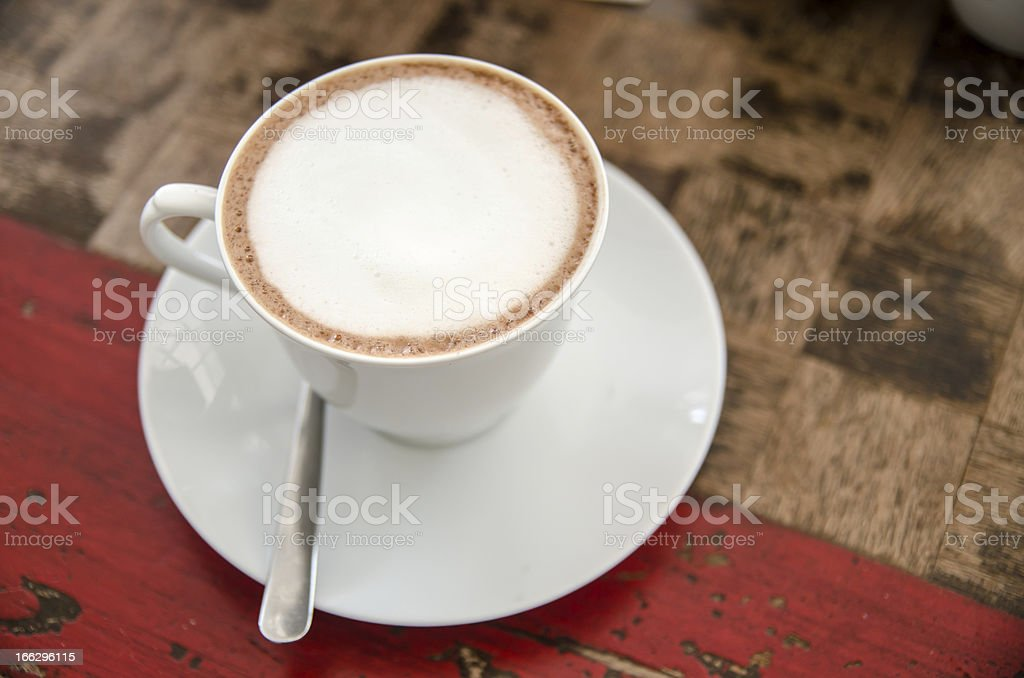 Coffee cup on the wood texture background royalty-free stock photo