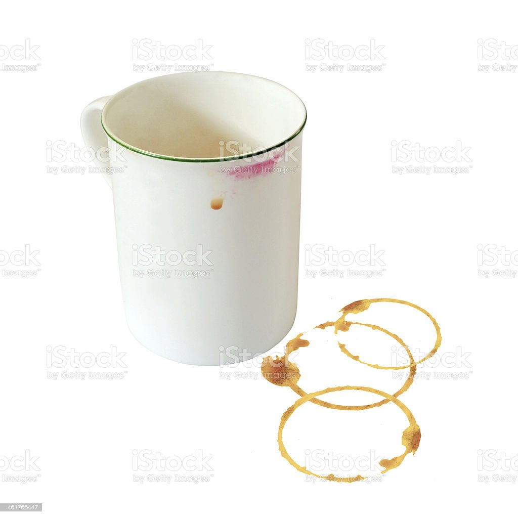 Coffee cup on white background with stains and lipstick. stock photo