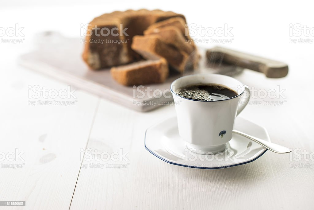 Coffee cup on white wood table stock photo