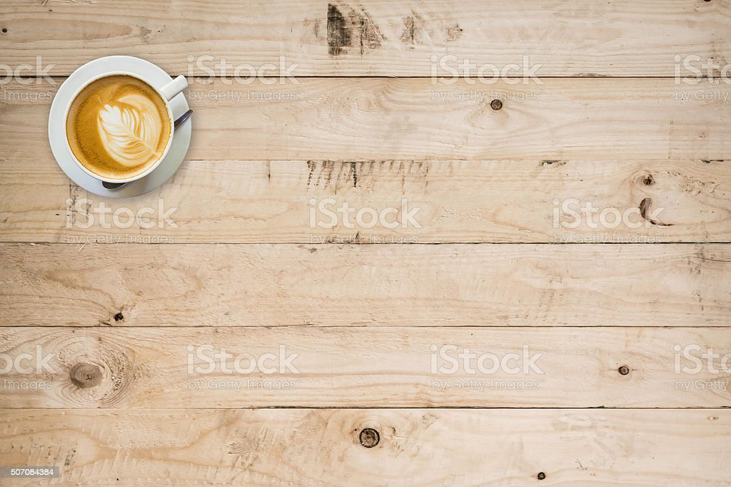 coffee cup on wood table with space stock photo