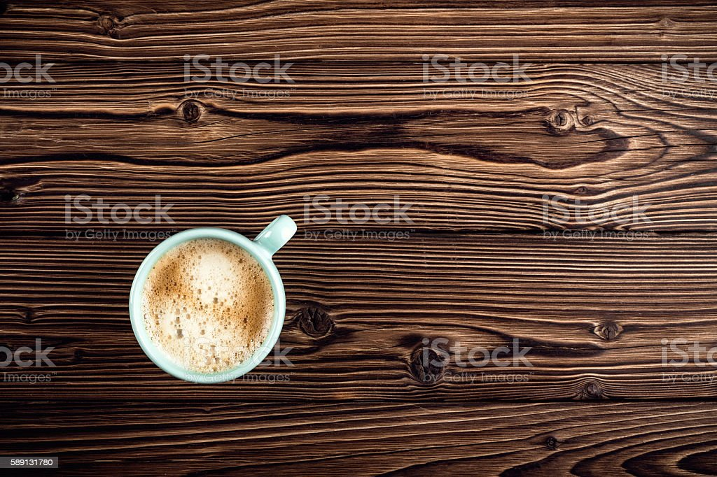 coffee cup on wooden background top view stock photo