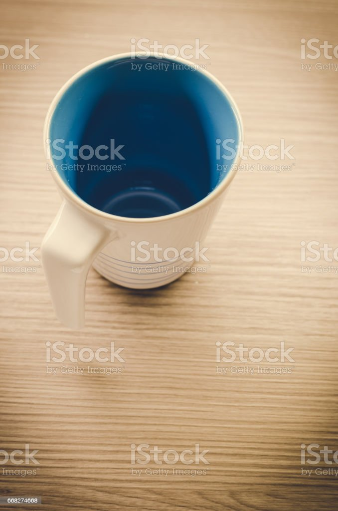 Coffee cup on wooden background: vintage tone stock photo