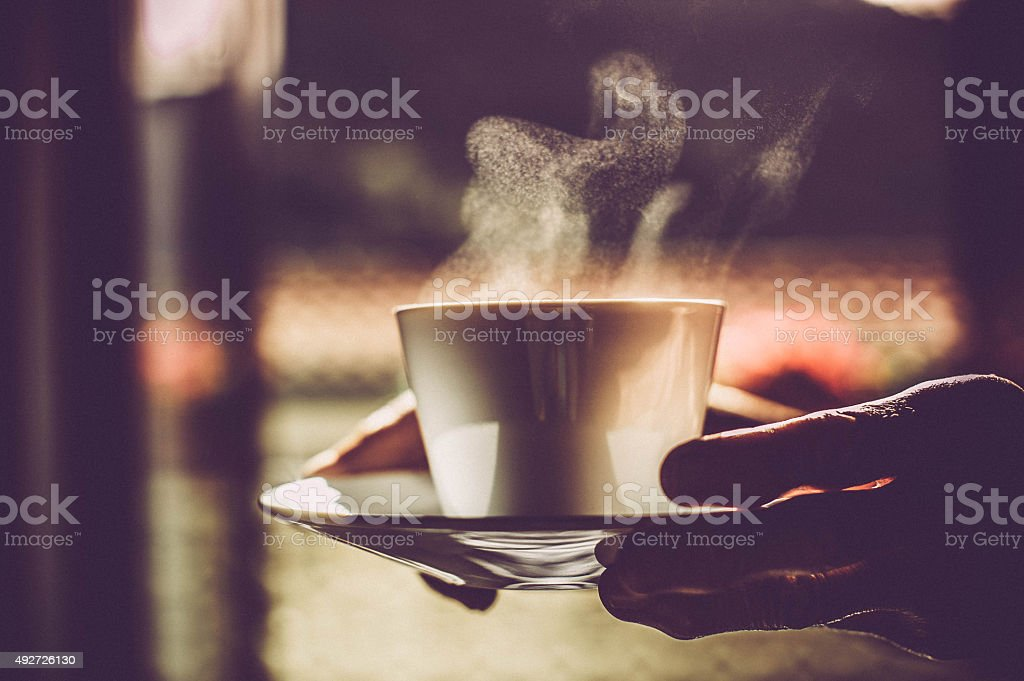 Hand Holding a Coffee Cup stock photo