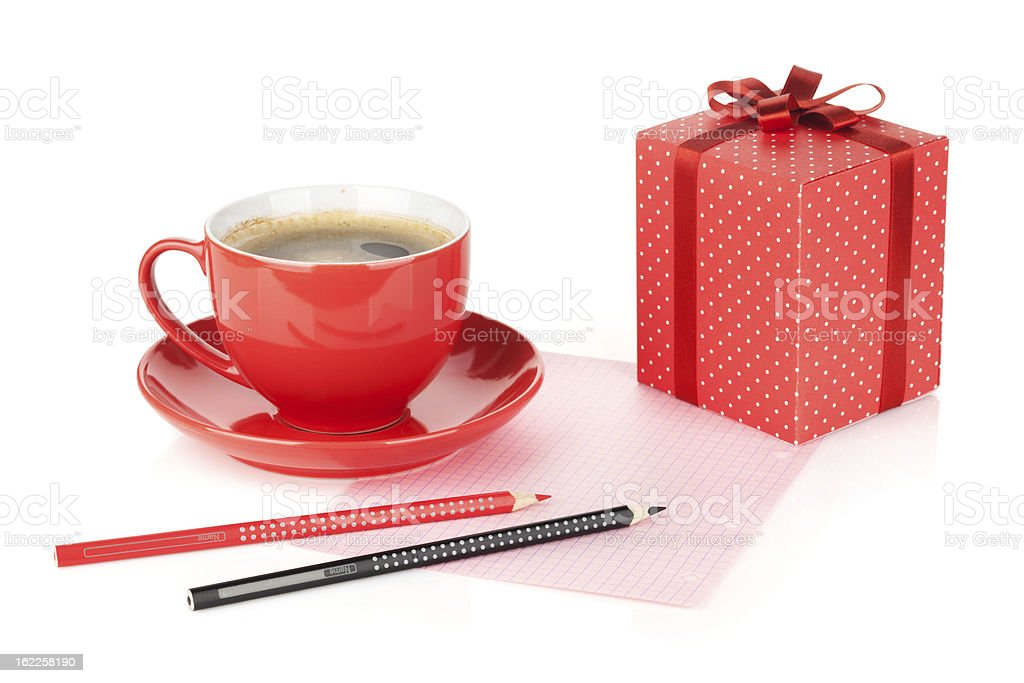 Coffee cup, red gift box and office supplies royalty-free stock photo