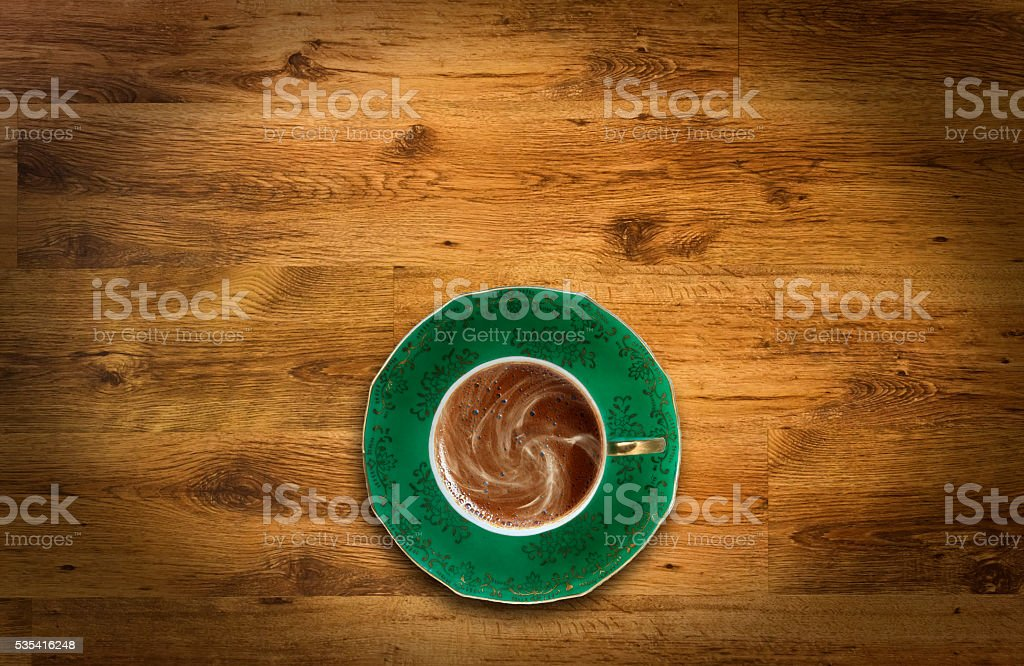 Coffee cup top view on wooden background stock photo