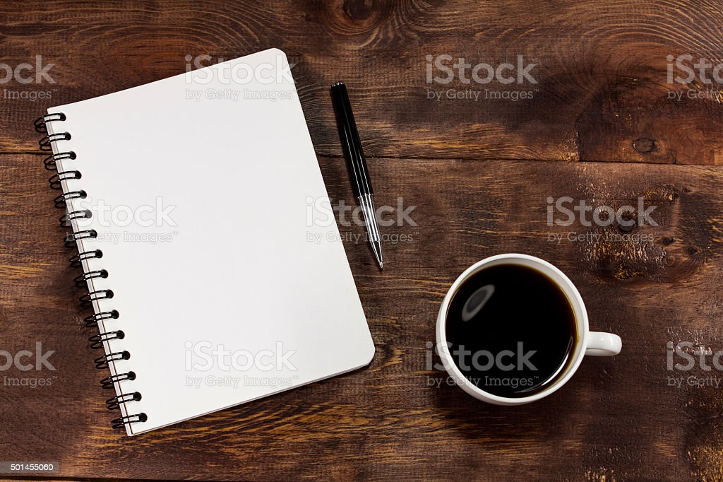 Coffee cup with a note book and a pen stock photo