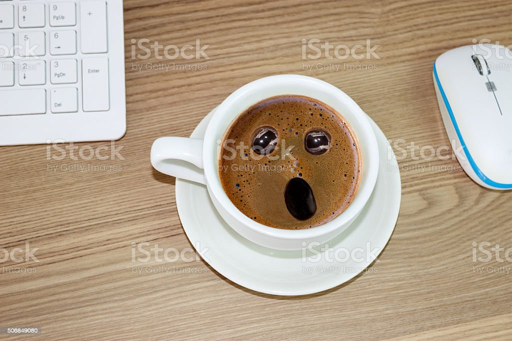 coffee cup with astonished expression  in cream stock photo