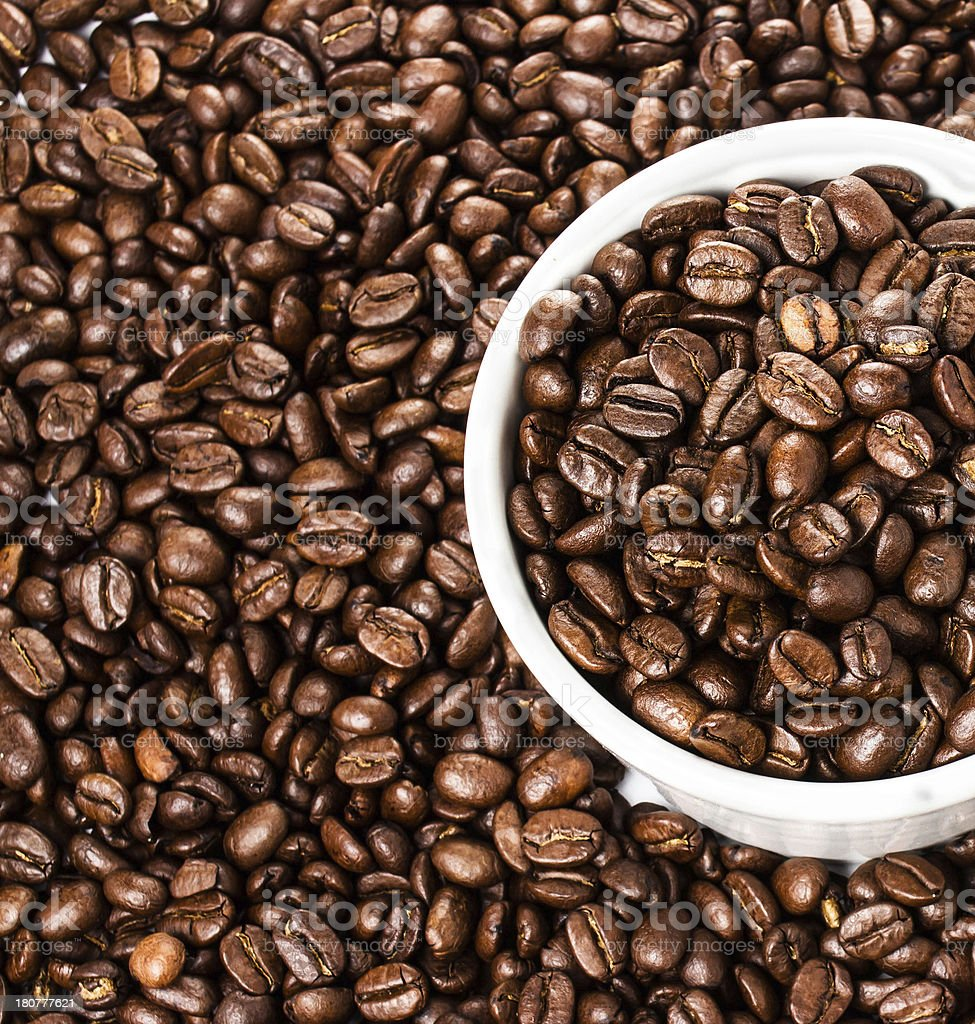 Coffee cup with beans on  background or texture, closeup. royalty-free stock photo