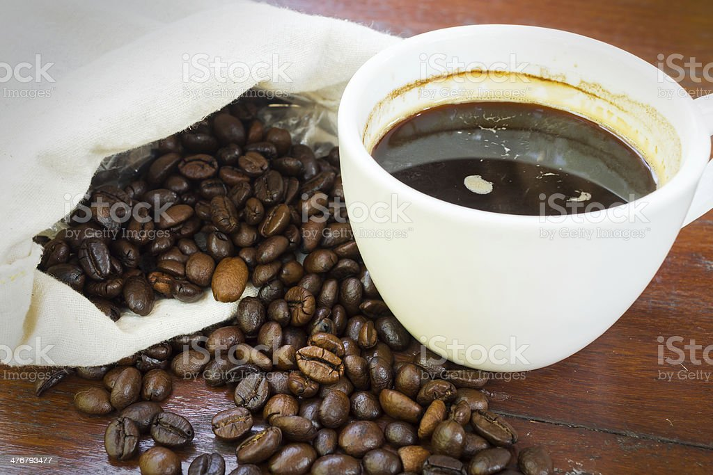 Coffee cup with beans. royalty-free stock photo