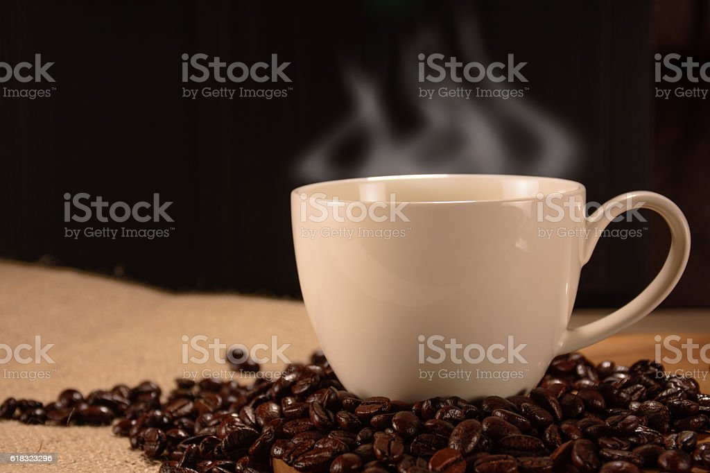 Coffee cup with beans, vintage style royalty-free stock photo
