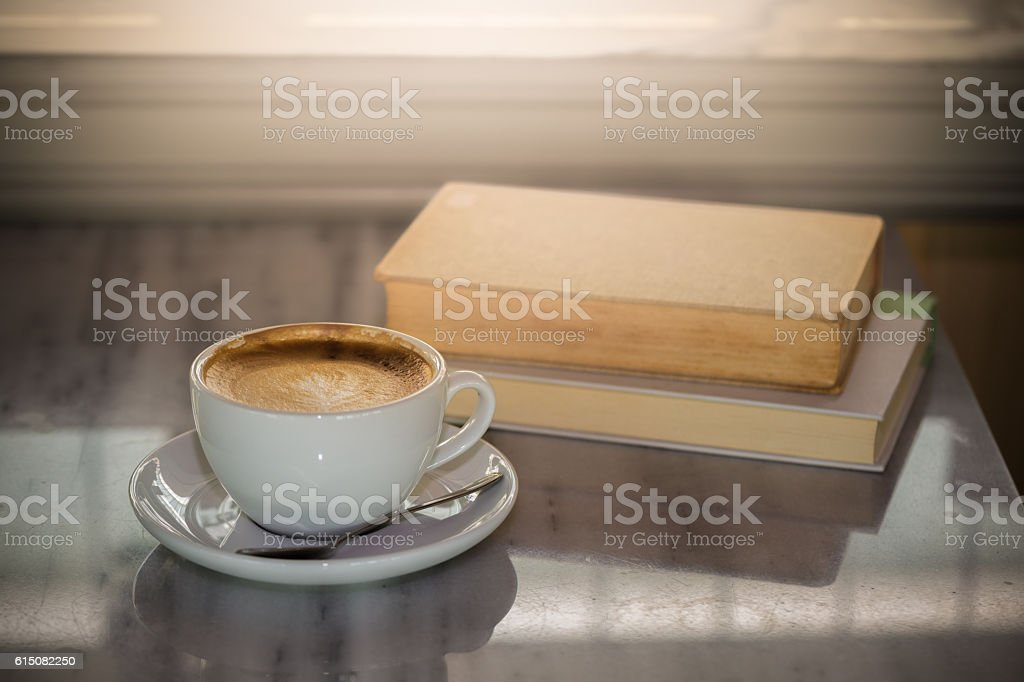 Coffee cup with book stock photo