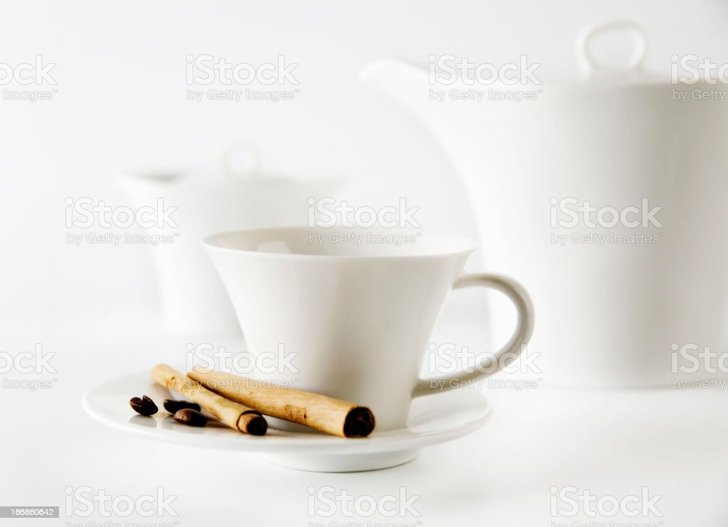 Coffee cup with cinammon sticks royalty-free stock photo