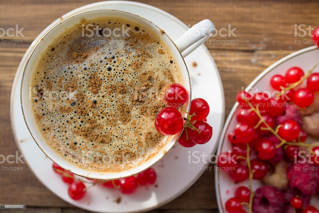 coffee Cup with cinnamon and fresh berries stock photo