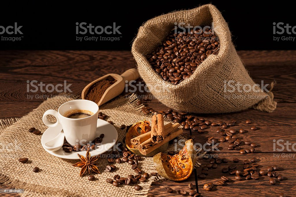 Coffee cup with cinnamon, star anise and dried orange fruit stock photo