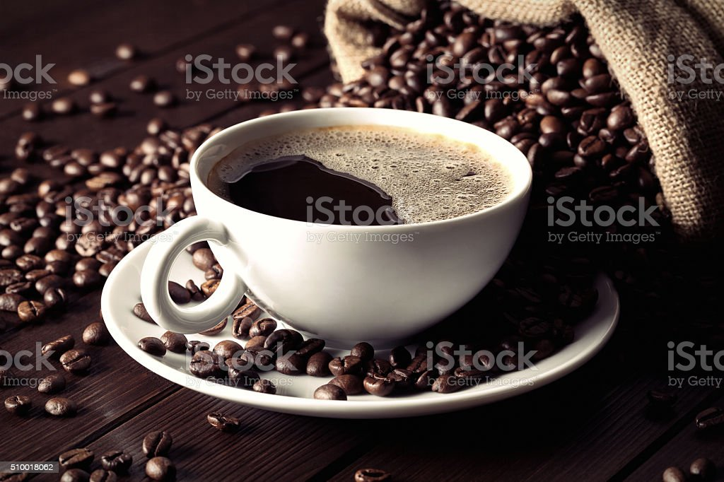 coffee cup with coffee beans stock photo