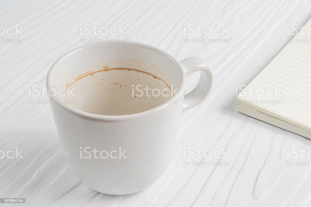 Coffee cup with coffee stains have not washed the cup stock photo