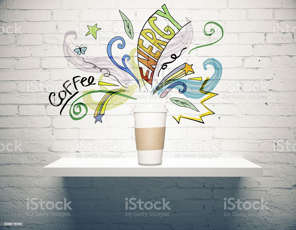 Coffee cup with drawings stock photo
