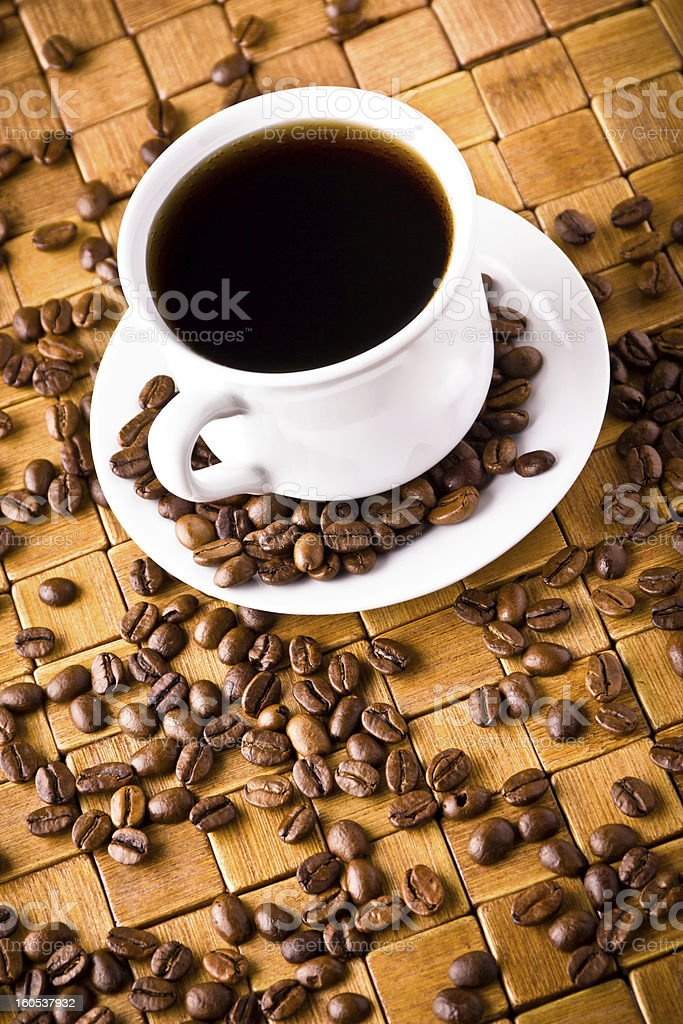 Coffee cup with fresh coffe beans for breakfast royalty-free stock photo