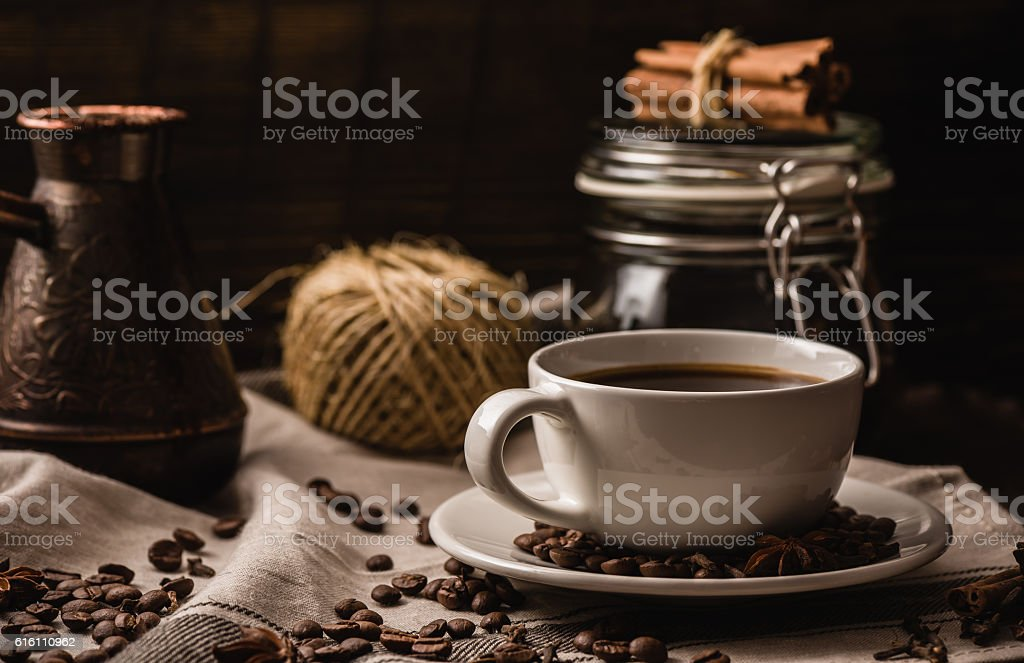 Coffee cup with igredients, beans and equipment stock photo