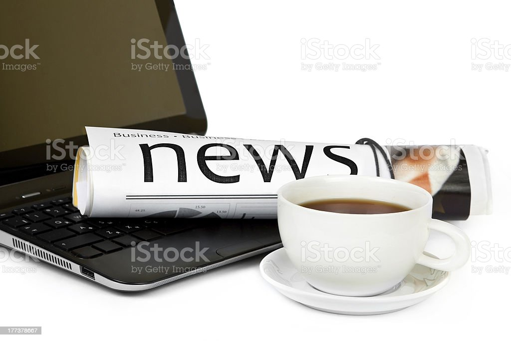 Coffee cup with laptop and newspaper royalty-free stock photo