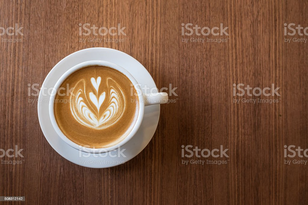 Coffee cup with milk and heart shape stock photo