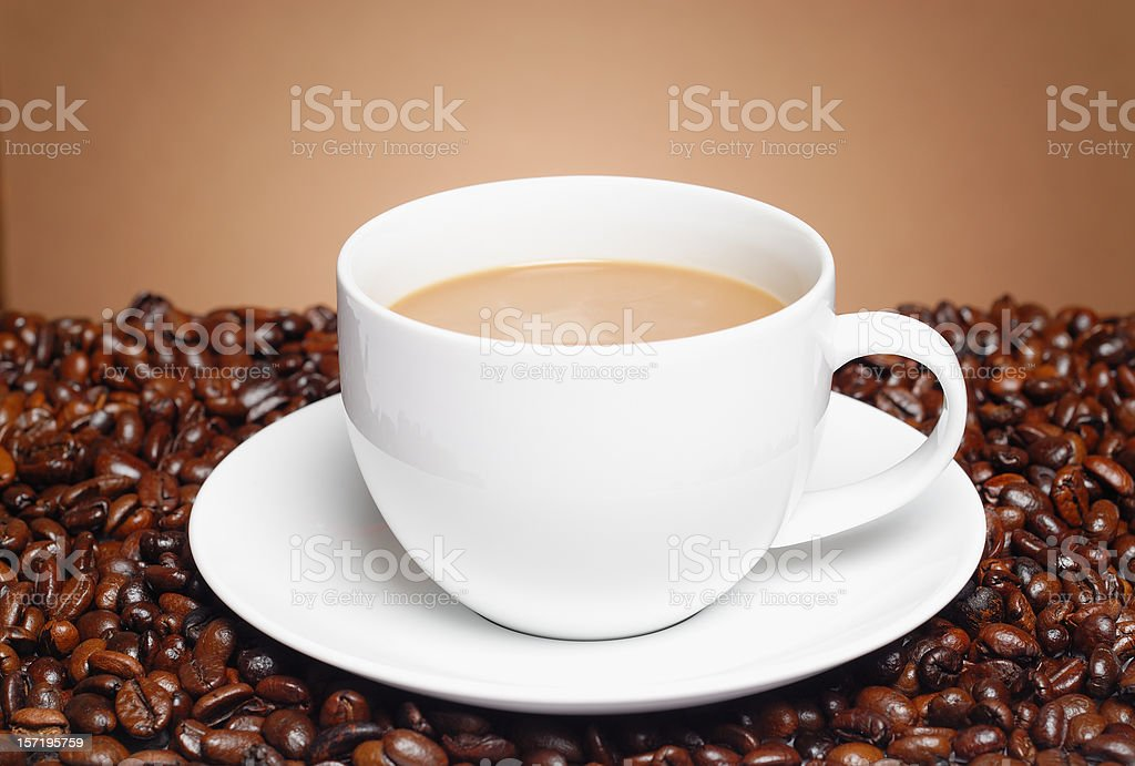 Coffee cup with premium beans royalty-free stock photo