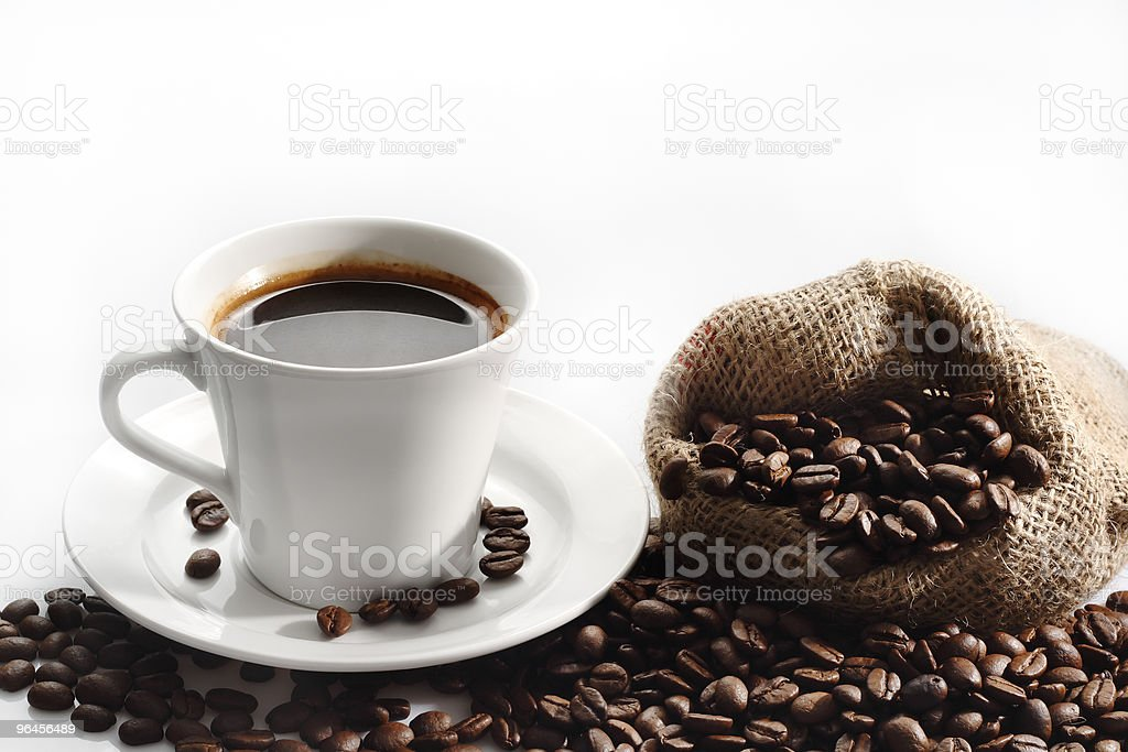 Coffee cup with sack of roasted beans on white background royalty-free stock photo