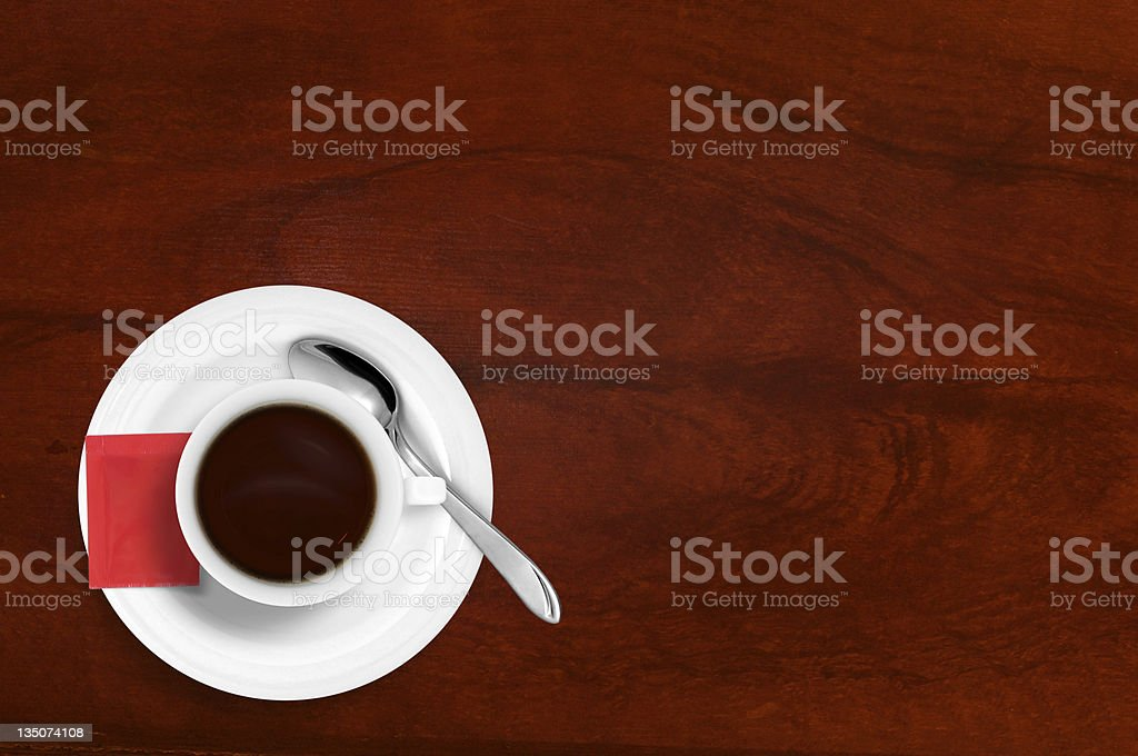 Coffee Cup with Spoon and sugar on red wooden table royalty-free stock photo
