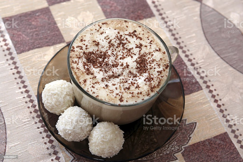 Coffee cup with three coconut cakes royalty-free stock photo