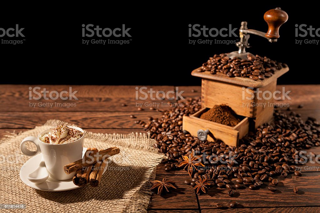 Coffee cup with whipped cream and coffee grinder stock photo