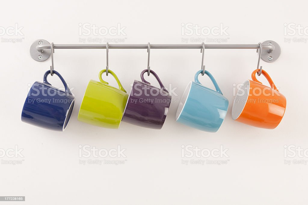 Coffee Cups Hanging on Rack royalty-free stock photo