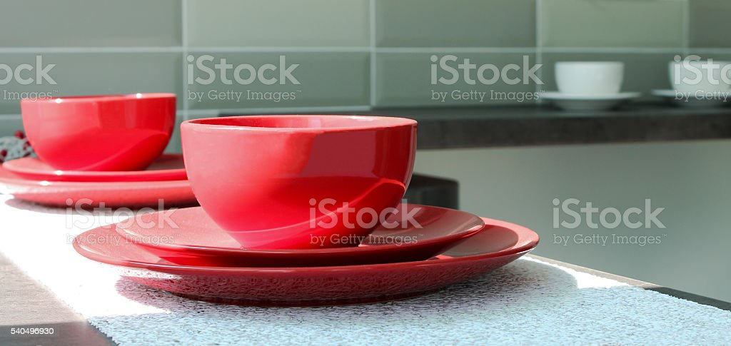 Coffee cups with plates on a table stock photo