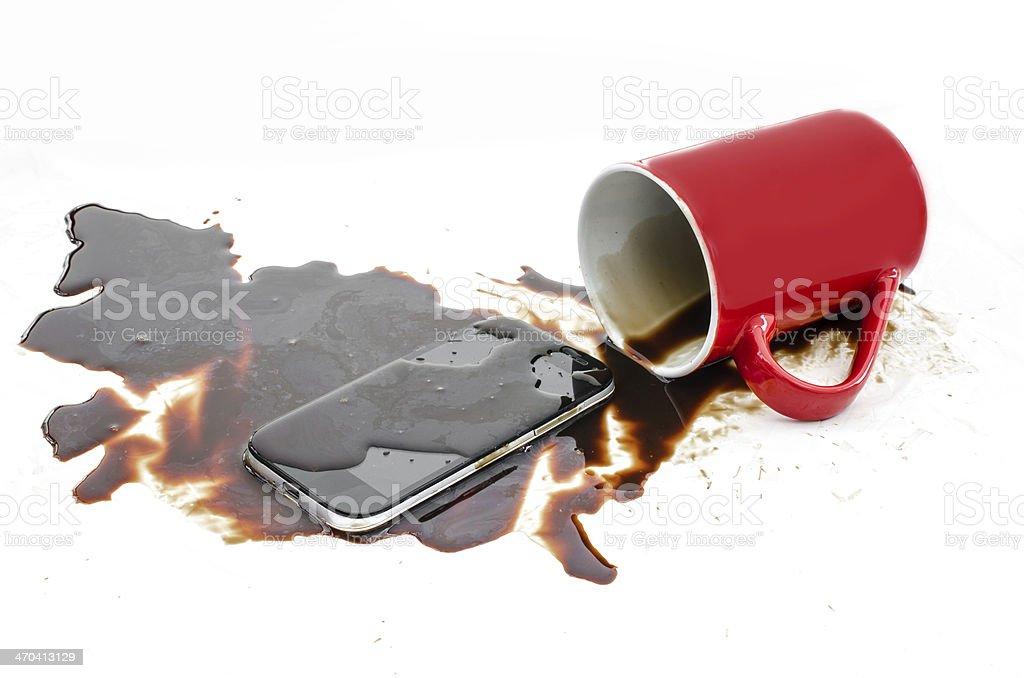 Coffee destroys mobile phone stock photo