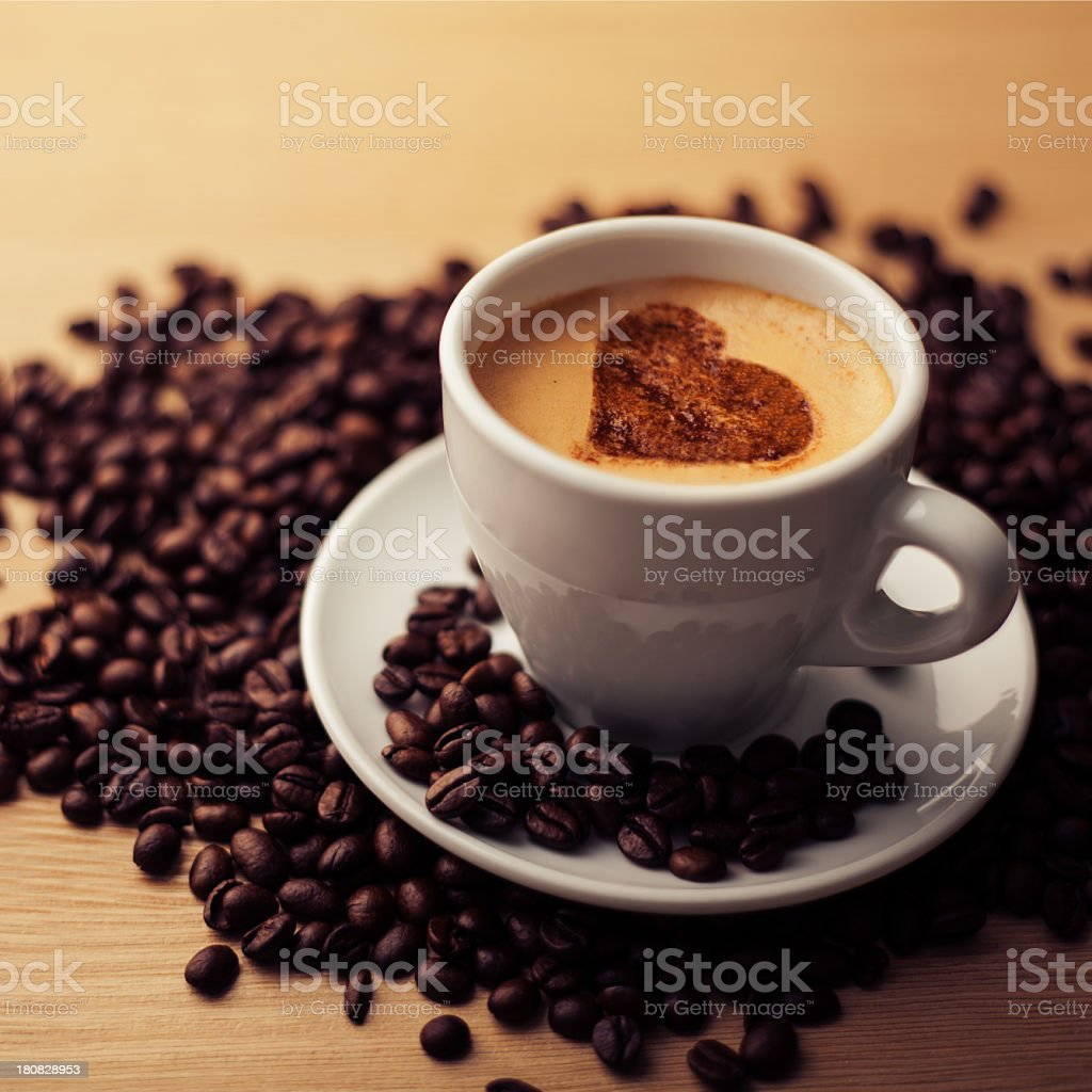 coffee drink and heart shape sprinkled with cinnamon royalty-free stock photo