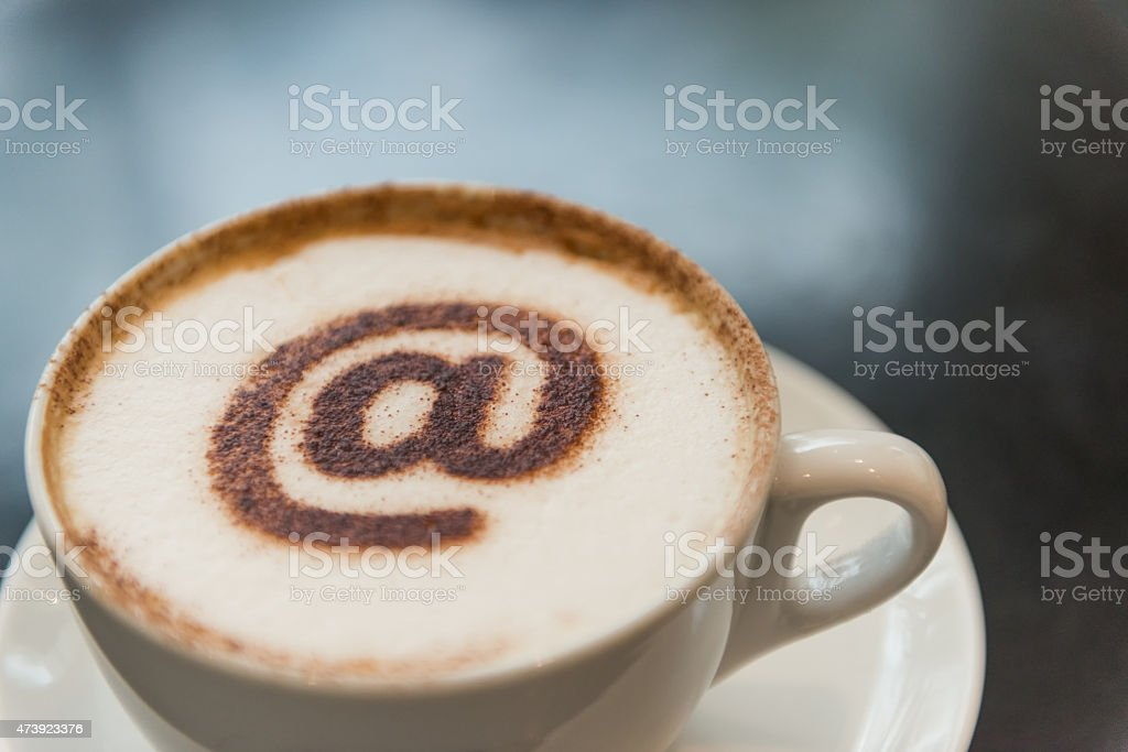 Coffee Drink in White Cup with @ Symbol and Copyspace stock photo