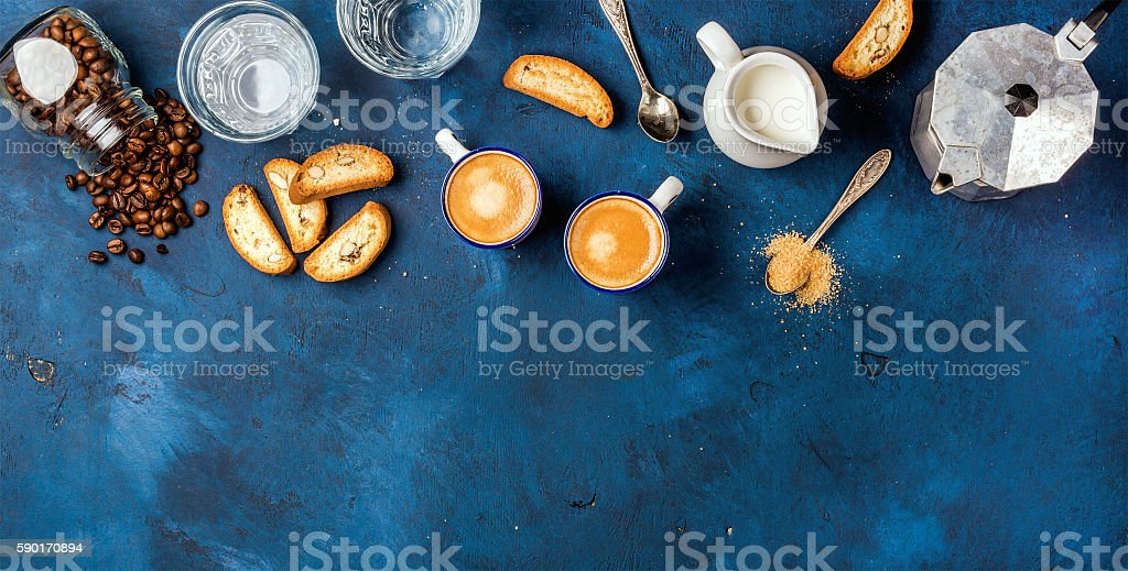Coffee espresso, cantucci, cookies and milk over dark blue background stock photo