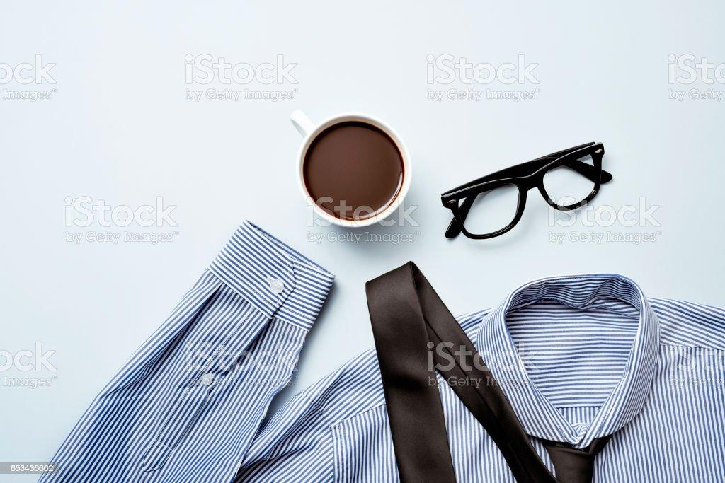 coffee, eyeglasses, tie and shirt stock photo