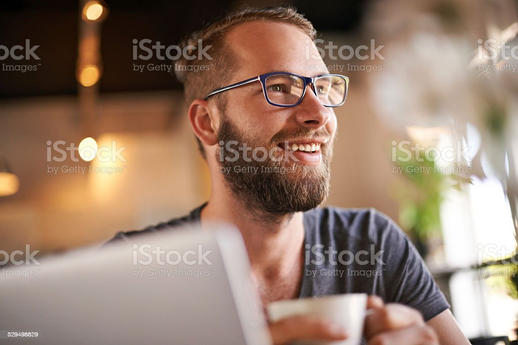 Coffee gets him going stock photo