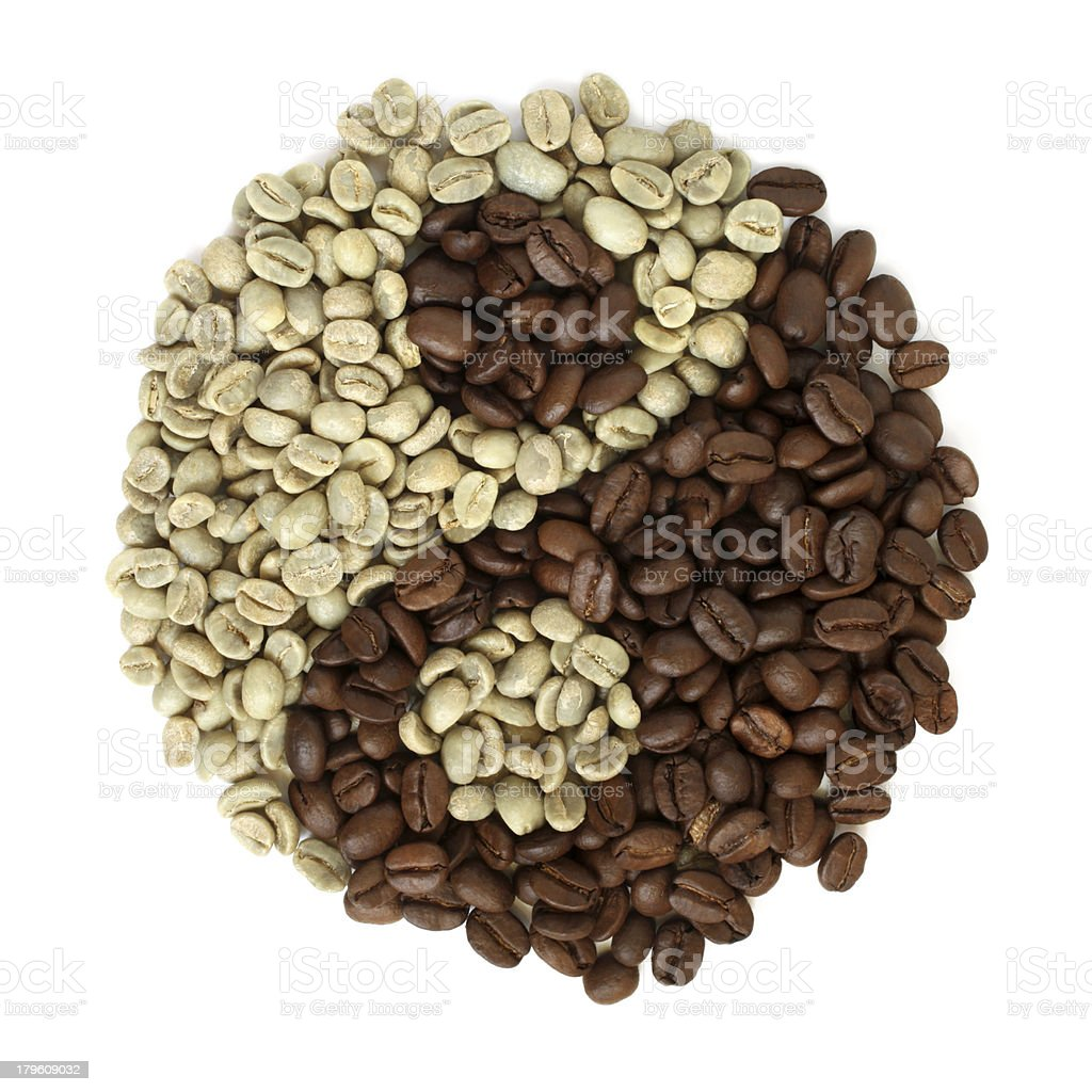 Coffee grains beans forming a yin yang symbol royalty-free stock photo