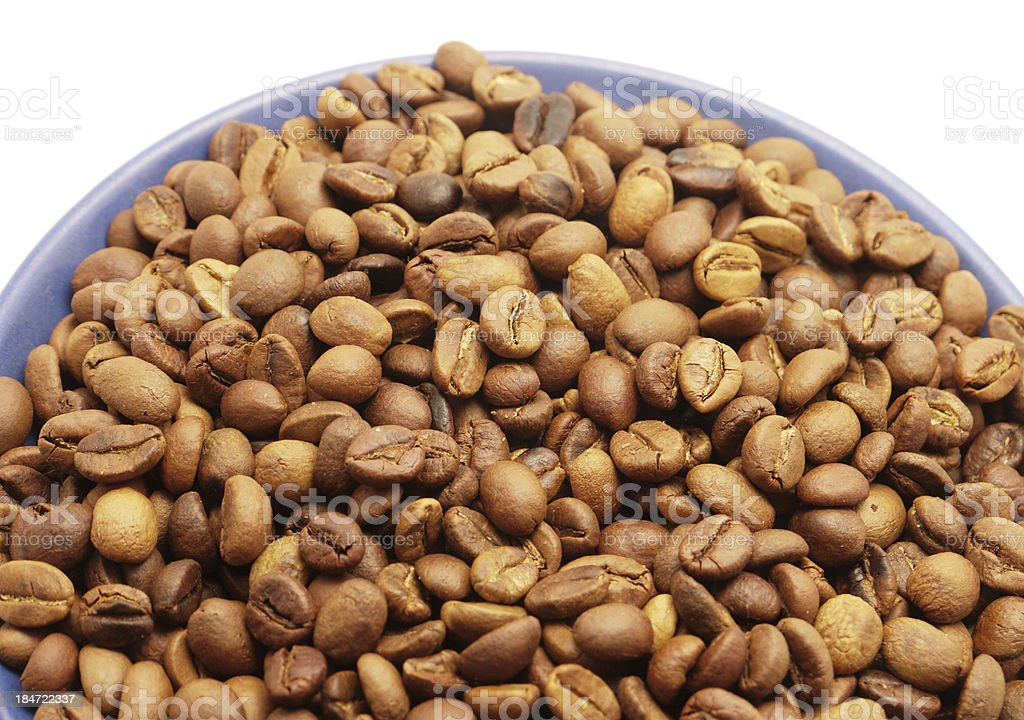 Coffee grains in a blue cup royalty-free stock photo