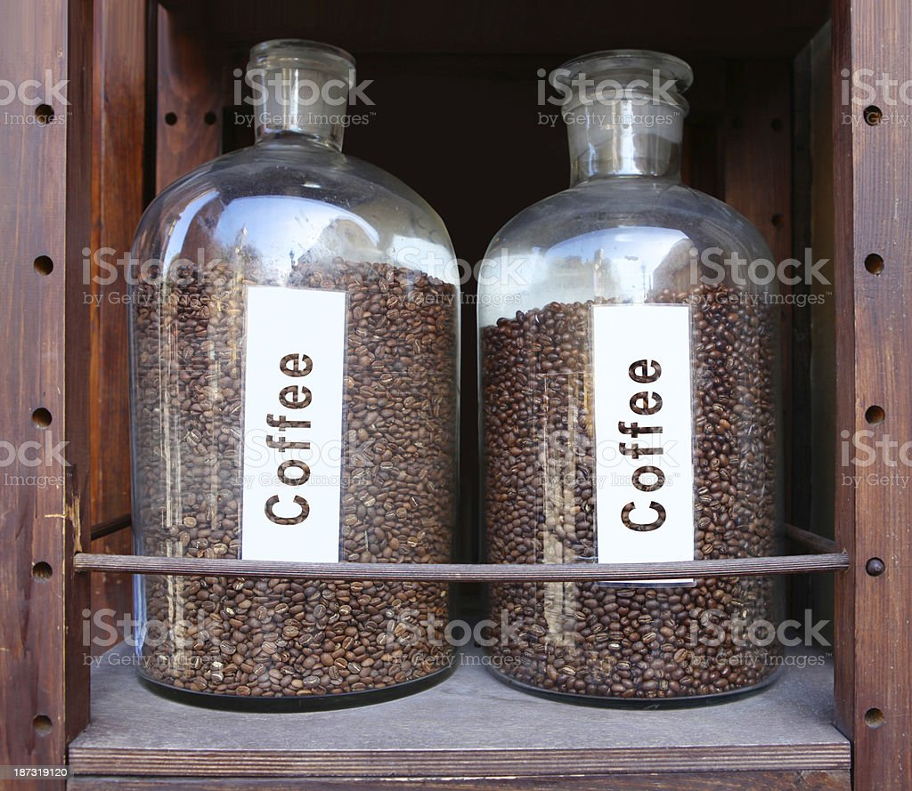 coffee grains in glass vessels royalty-free stock photo