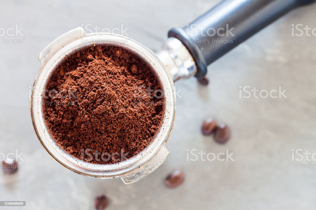 Coffee grind in group with coffee bean stock photo