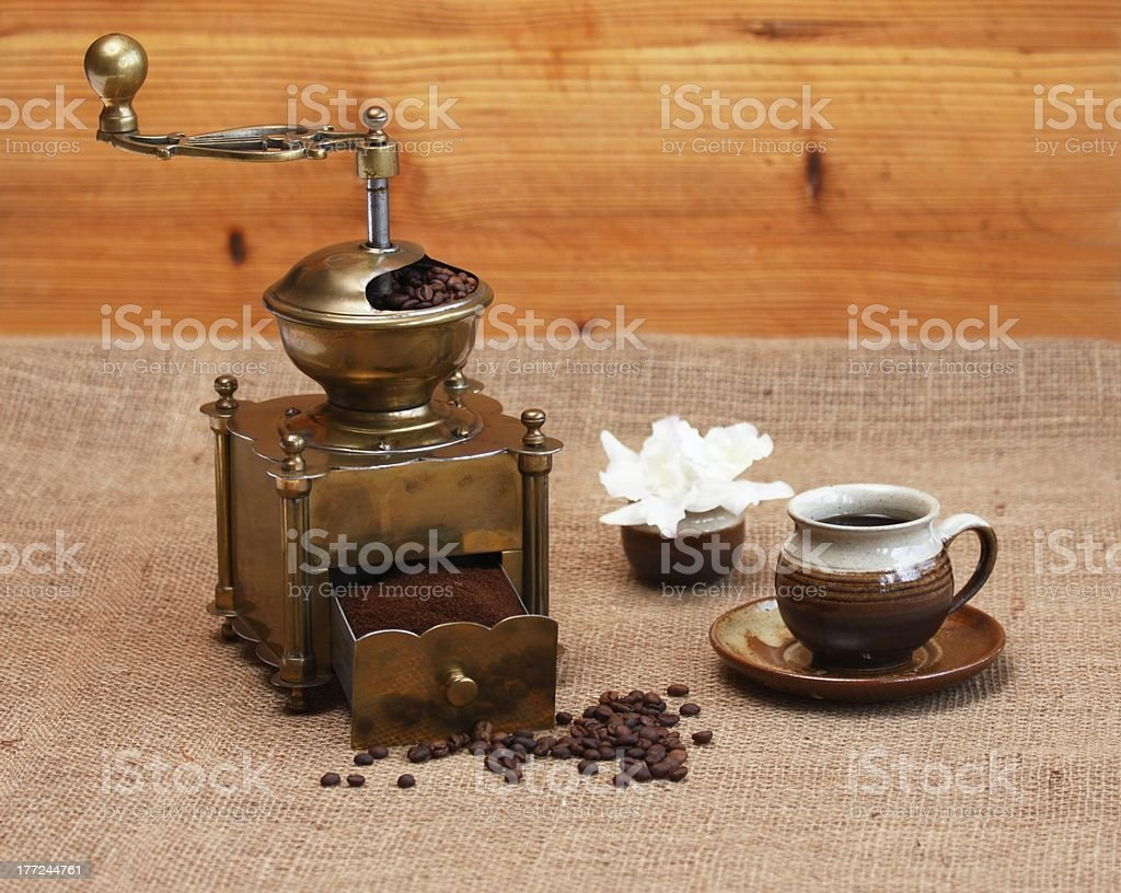 Coffee grinder and cup royalty-free stock photo
