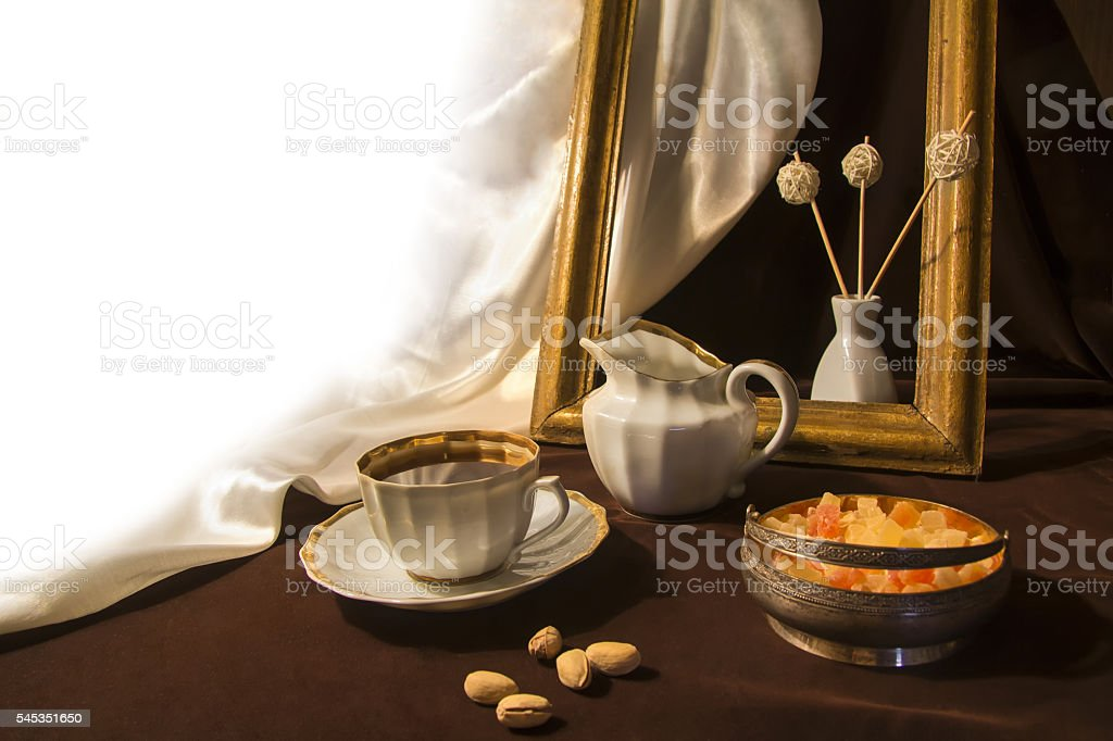 Coffee grinder, cup on the table. stock photo