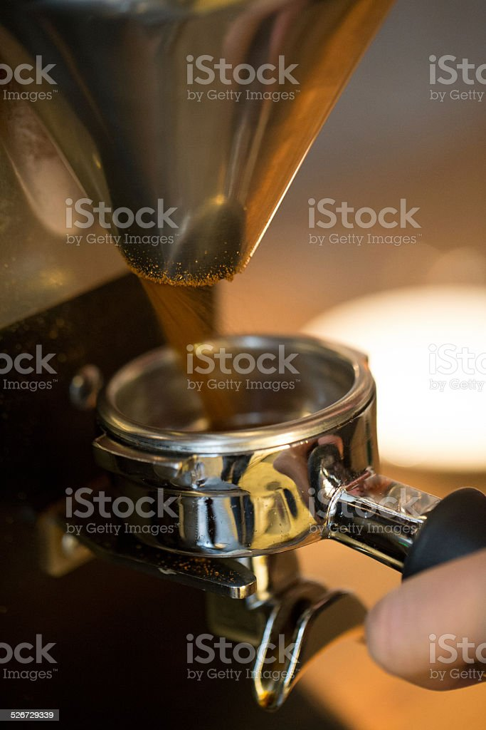 coffee grinder in action stock photo